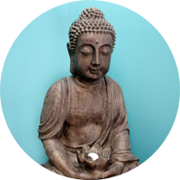 photo of statue of Buddha holding lotus
